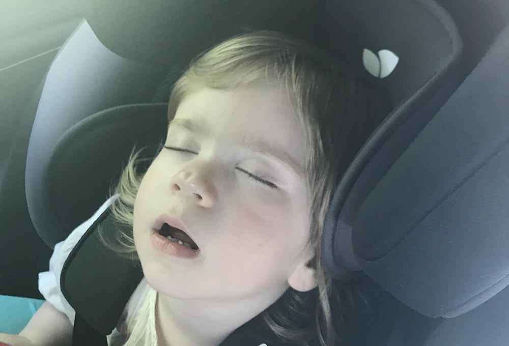 One tired little girl after a long day of travelling by train and car
